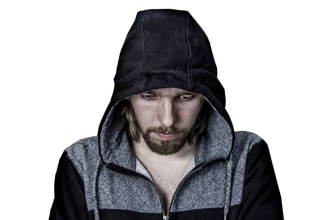 Man feeling guilty wearing a hoody