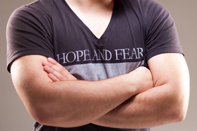 Man with arms crossed wearing hope and fear t-shirt